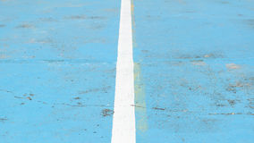 Line in the blue floor. The white line in the blue floor Royalty Free Stock Photos