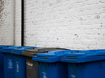 Line of blue and grey council bins in Maidenhead, Berkshire Stock Images