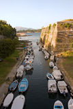 Line of boats. In a narrow canals near the Corfu castle Stock Photo