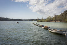Line of Boats Afloat in a Reservoir, Kent, UK Royalty Free Stock Photo