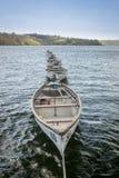 Line of Boats Afloat in a Reservoir, Kent, UK Stock Image