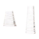 Line border made of multiple safety pins isolated on white background, set of different foreshortenings Stock Photos
