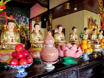 Line of buddha statues in Buddhist temple stock photos