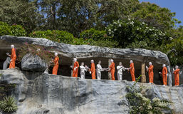 A line of Buddhist monk statues at the Golden Temple at Dambulla, Sri Lanka. Royalty Free Stock Photography