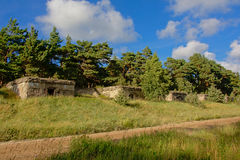 Line of bunkers in the forest at Karosta old military base, Liepaja. Line of sovjet bunkers along a dirt road in the pine forest, part of an old fort in the Royalty Free Stock Photography