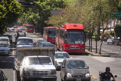 Line 1 Bus at Mexico City. Mexico City, Mexico- May 30, 2012: View of a row of Line 1 Metrobuses heading to Caminero at a the Insurgentes Avenue. Insurgentes is Stock Photo