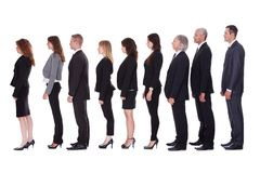 Line of business people in profile Royalty Free Stock Image