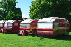 Line of caravans in red Stock Images