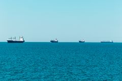 Line of cargo vessels at the horizon sailing to Hamburg royalty free stock photos