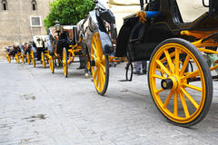 Line of carriages waiting for tourists in Sevilla Stock Images