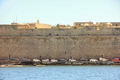 Line of cars parking in port Grand Harbor, Valletta stock images