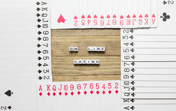 On line casino text cube concept art. On line casino text inside border made of playing card stock images