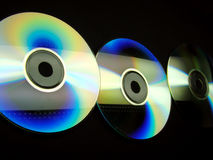 Line of CD's. Three CD's forming a colorful line Stock Images