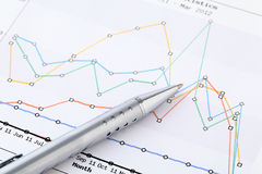 Line chart and pen Stock Photography