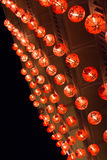 Line of chinese lanterns hanging for new year festival Stock Photos