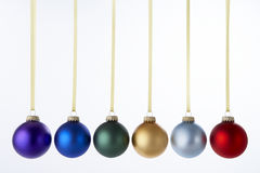 Line Of Christmas Baubles. Against White Background Stock Photography