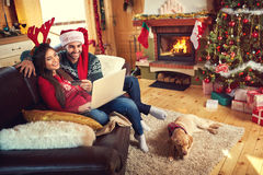 On line Christmas shopping from internet Stock Photo