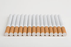 A line of cigarettes Stock Photography
