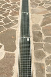 The line of city sewerage or water drainer. The straight line of a city sewerage or water drainer from park in sunlight Stock Photo