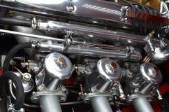 In-line classic car engine carburetors. Stock Image