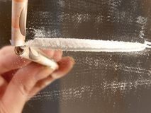 Line of cocaine and a euro bill Stock Images