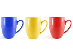 Line of color cups. On the white background stock image