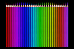 Line of colored pencils on black background Stock Photography