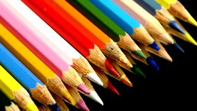 Line of colored pencils on black, reflection stock video footage