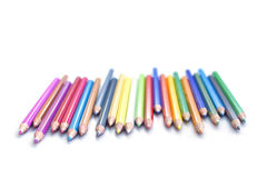 Line of colored pencils. Deranged line of watercolor colored pencils on white royalty free stock images