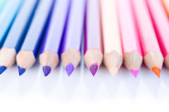 Line of colored pencils with shadow. Royalty Free Stock Photography