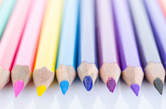 Line of colored pencils with shadow. Royalty Free Stock Images