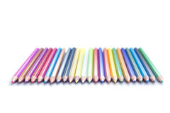Line of colored pencils. Strait Line of watercolor colored pencils on white royalty free stock photos