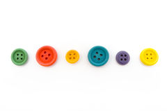 Line of colorful buttons over white Royalty Free Stock Photo