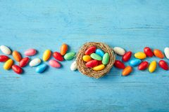 Line of colorful Easter egg candy with nest stock image