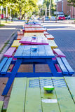 Line of Colorful Picnic Tables Royalty Free Stock Images