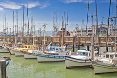 Line of Colorful Sailing Boats at Fishermans Wharf of San-Francisco Bay in California,United States. Horizontal Image Composition stock photography