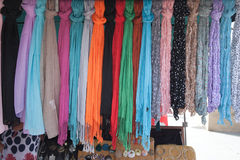 Line of colorful shawls on the market Stock Image