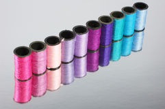 Line of colorful threads. On silver paper Royalty Free Stock Image