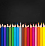 Line of colorful wooden pencils on black Royalty Free Stock Photo
