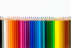Line of colour pencils isolated on white background royalty free stock photo