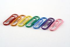 Line of Coloured Paperclips. Rainbow coloured paperclips Royalty Free Stock Photo