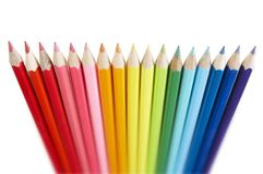 Line of coloured pencils on white background Royalty Free Stock Images