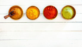 Line of colourful ground spices Royalty Free Stock Image