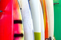 Line of colourful surfboards Stock Images