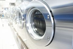 Laudry room washing machines. Line of commercial washing appliances Stock Images
