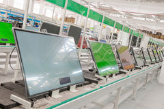 Line conveyor assembly televisions. Closeup line conveyor assembly and testing televisions in a workshop royalty free stock image