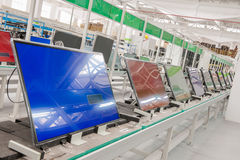 Line conveyor assembly televisions. Closeup line conveyor assembly and testing televisions in a workshop Royalty Free Stock Photography