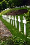 Line of cross white with a cemetery. Royalty Free Stock Photos