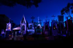 Line of blue and pink lightened tombstones during dawn in Cementerio General in Merida, Mexico stock photos