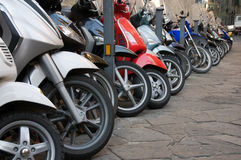 Line of different motocycles. On stone road Royalty Free Stock Images